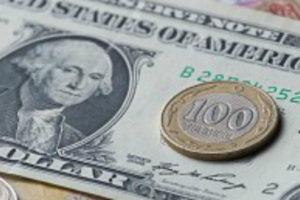 Более чем в 82 раза подешевел тенге относительно доллара с момента введения в обращение